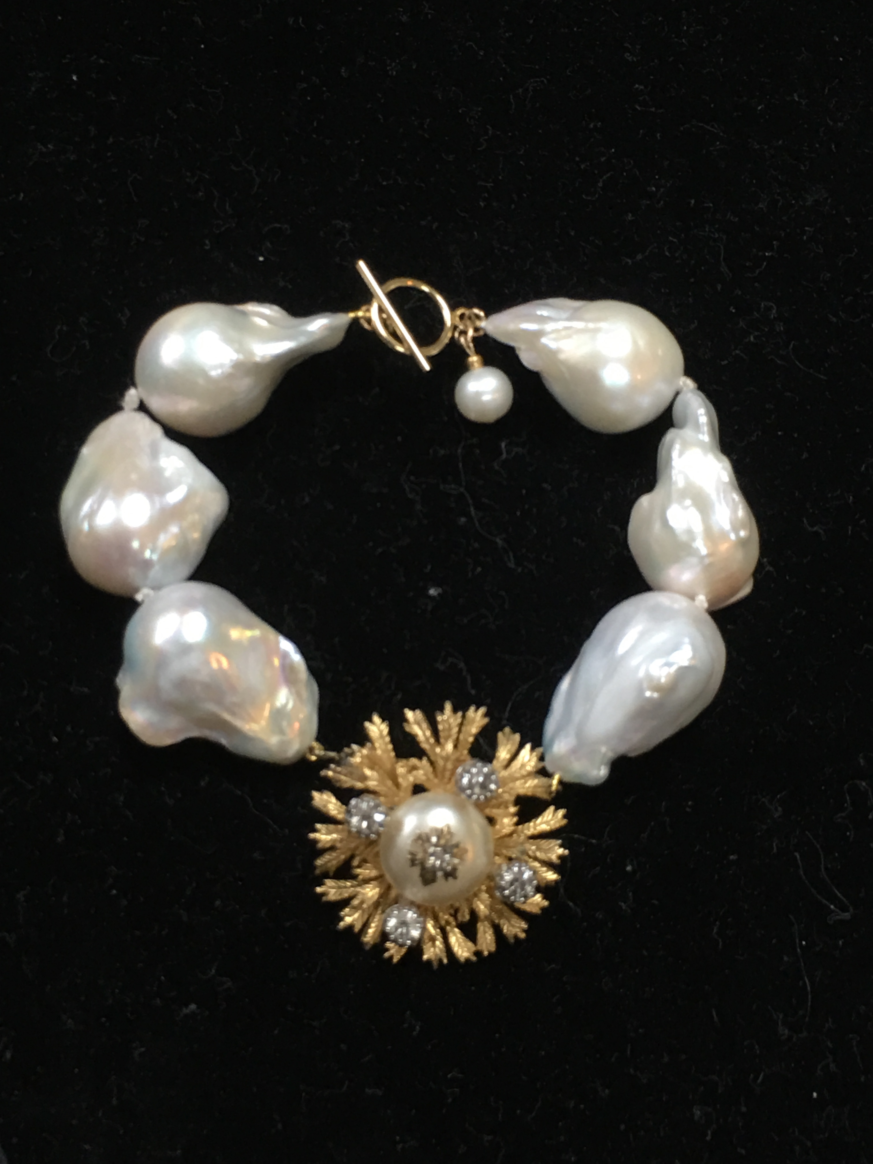 Freshwater Fireball Pearl Bracelet w/Vintage charm finished w/14KG filled clasp.
